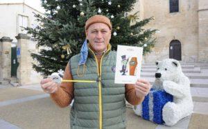 Read more about the article Insolite : le maire de Baillargues offre un mètre avec sa carte de vœux.